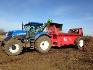 Merlo loading muckspreader with FYM